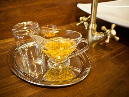Tray with cups full of gold drink which is used in the therapeutics photo
