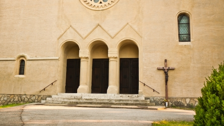 Portico of the church with entrance staircase and Cross with Jesus Christ on the right side photo