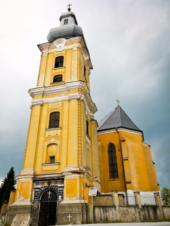 Front view of the majestic church with a tower photo