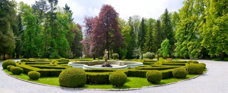 And ornamental fountain in a formal garden Stock Photo