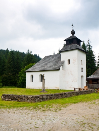 Old white christian church in the nord Slovakia region photo