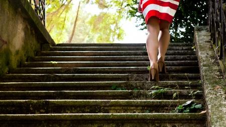 Elegant women legs on the stone stairway Stock Photo