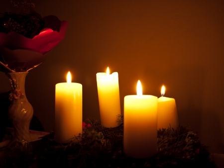 Advent wreath with four burning candles on Christmas background photo