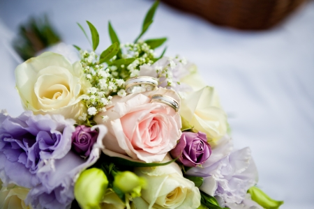 Beautiful colorful wedding bouquet with a pair of rings