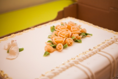 Wedding cake with two doves and sugar flowers photo