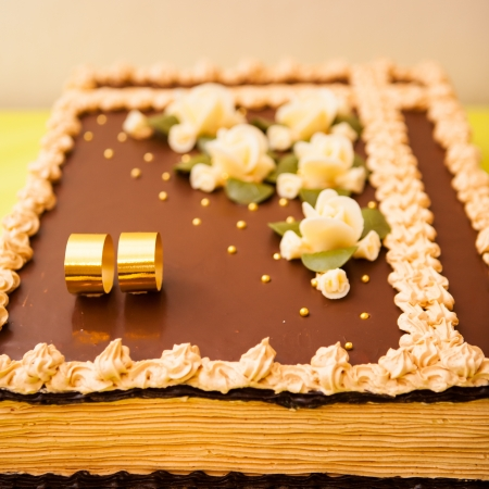 Bride cake with two rings and flowers made from sugar photo