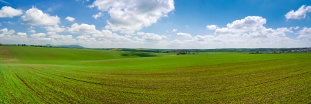 agrarian: Beautiful panorama landscape of agrarian field with cloudy sky Stock Photo