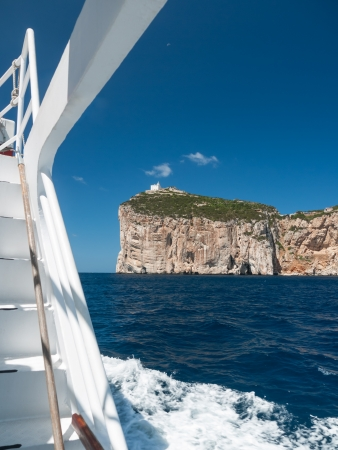 Seascape of Capo Caccia with lighthouse tower photo