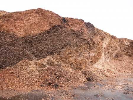 Pile of wood chips ready to be spread Stock Photo