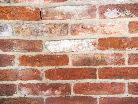 Close up of old red brick wall photo