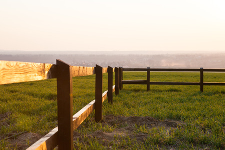 Close up view of wooden fence in grassy landscape photo