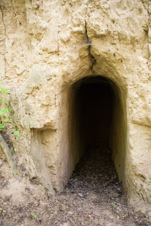 catacomb: Entrance to the underground passages built by man for the defense during the war Stock Photo