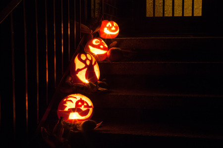 Night scene closeup with glowing scary pumpkins Stock Photo