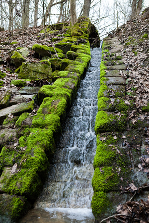 manmade: Small man-made water fall in a humid environment