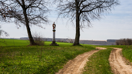 patron of europe: St. Urban statue between two lime trees near a country road