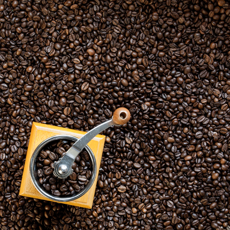 coffee grinder: Top view on coffee grinder with coffee beans Stock Photo