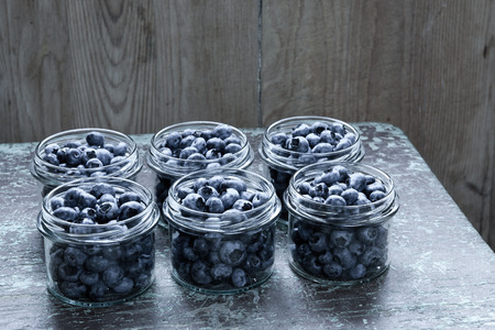 Jar of blueberries fruit compote on wooden table Stock Photo