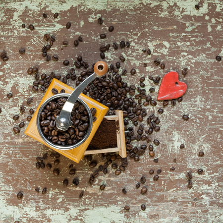 Old coffee grinder and red colored heart shape Stock Photo