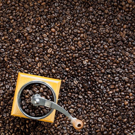 Roasted coffee beans and manual coffee grinder Stock Photo