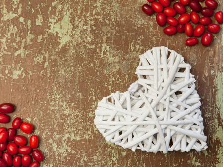 Ripe juicy berries of dogwood and shape of heart Stock Photo