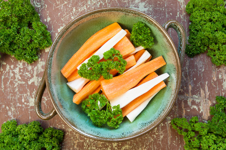 Parsley and carrots garnished with green leaf in a bowl Stock Photo