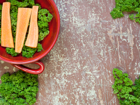 Portion of fresh cutted herbs and carrots in a bowl Stock Photo