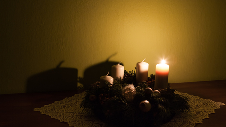 Homemade advent wreath with one burning candle Stock Photo