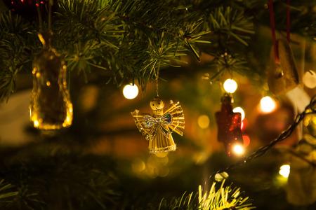Christmas angel hanging on a christmas tree branch