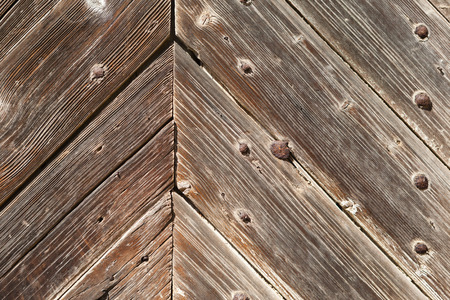Old wooden historic house door close up