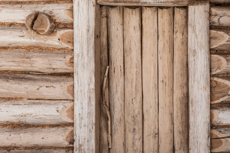 Old wooden doors to a traditional Slavic cottage Stock Photo