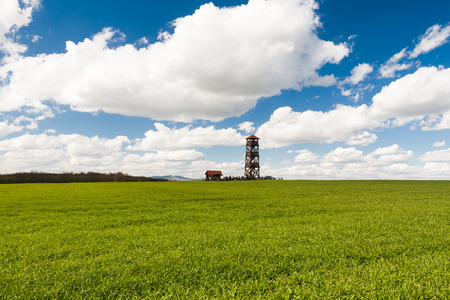 Lookout tower Radosinka with many visitors located on the top of a hill under blue sky with beautiful clouds Stock Photo