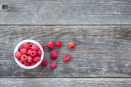 Top view of ripe raspberries on wooden background with copy space for text Stock Photo