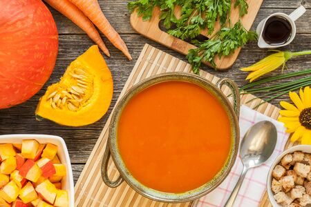Top view of pumpkin soup with ingredients and croutons on table Stock Photo