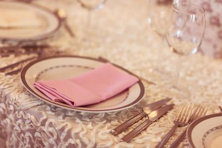 Pink napkin on a plate photo