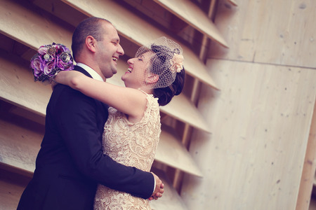 honeymoon suite: Bride and Groom posing on their wedding day