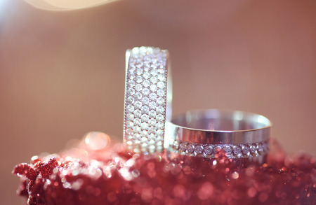 jewelle: two wedding rings with diamonds