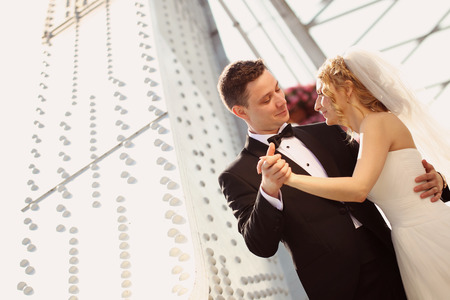 a newly married couple: groom and bride having fun Stock Photo