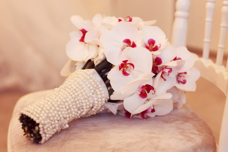 wedding bouquet on a chair photo