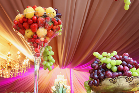 cater: fruit, decoration, event, decor, arrangement, fine, formal, banquet, strawberry, table, berry, plate, white, prom, cloth, serve, reception, marriage, restaurant, orange, luxury, celebration, setting, service, pineapple, elegant, dinner, cater, interior, r