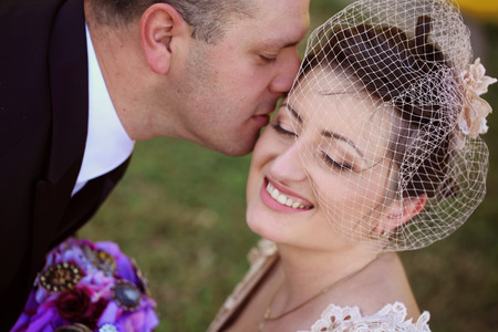 relational: groom kissing bride Stock Photo