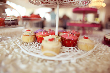 table skirt: Delicious cupcakes on table