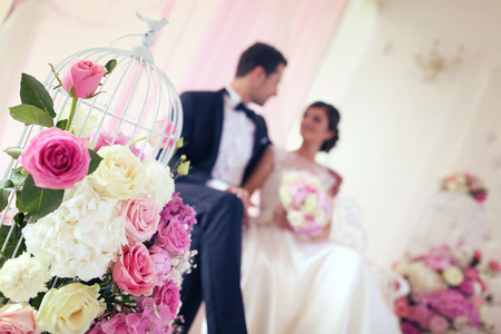 bride bouquet: Bride and groom surrounded by flowers