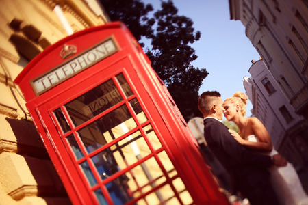 phonebooth: Bride and groom near phonebooth