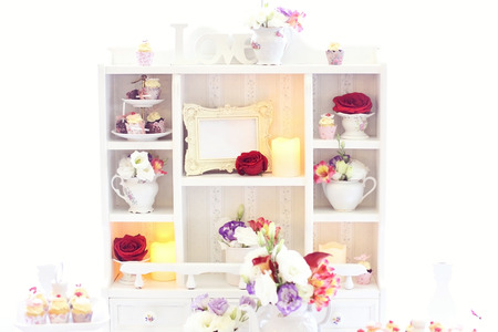 shelve: White shelve with flowers and sweets for a wedding