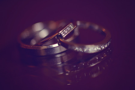 matrimony: Wedding rings on table
