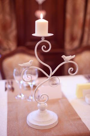 white metal: Candles on white metal Stock Photo