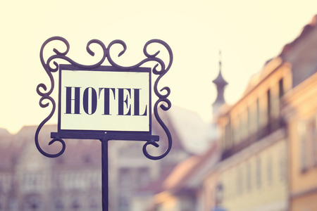 hotel sign: Beautiful old hotel sign in the city Stock Photo