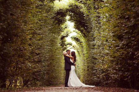 Bride and groom in garden of Schonbrunn, Vienna