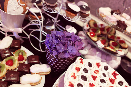 afternoon fancy cake: Mix of wedding sweets on table