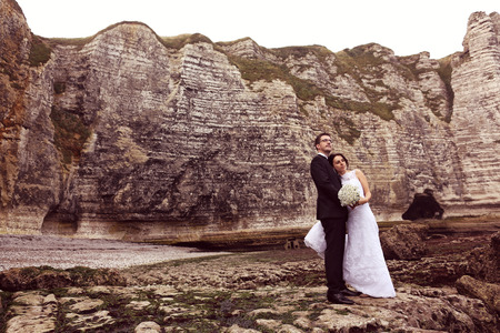 trash the dress: Bride and groom at the ocean